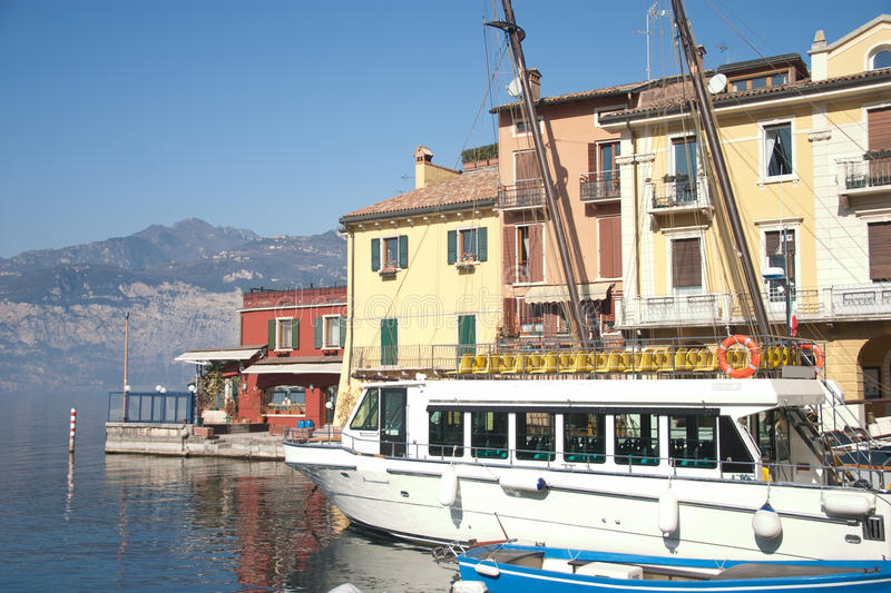 Tourist Boat In The Harbor Of Malcesine Stock Image
