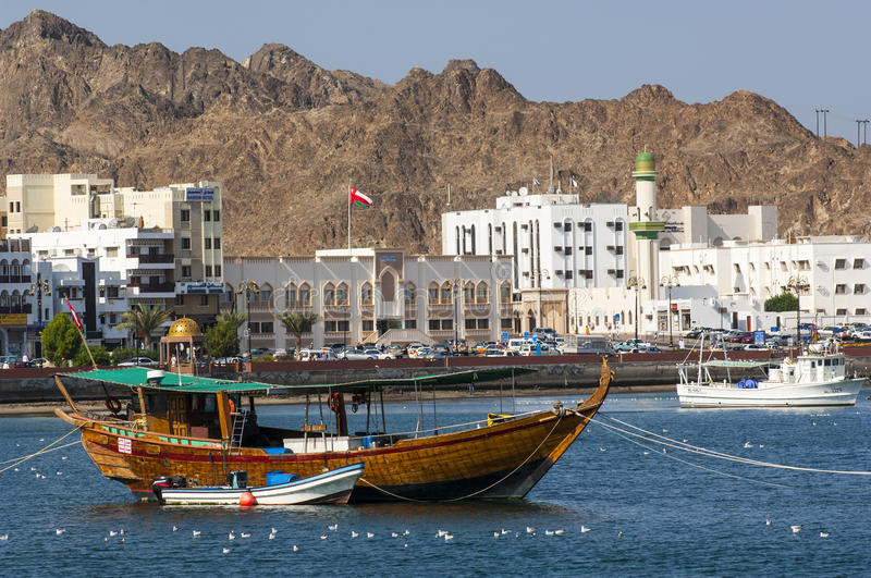 A tourist boat moored in the harbour of Muscat royalty free stock images
