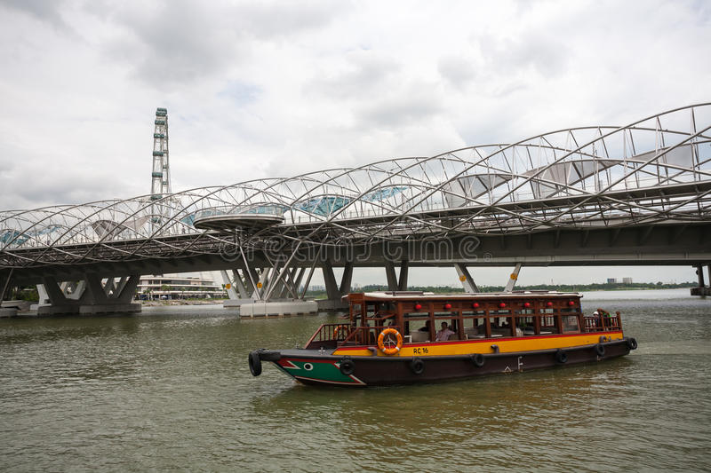 Tourist boat moving along the Singapore River stock photography