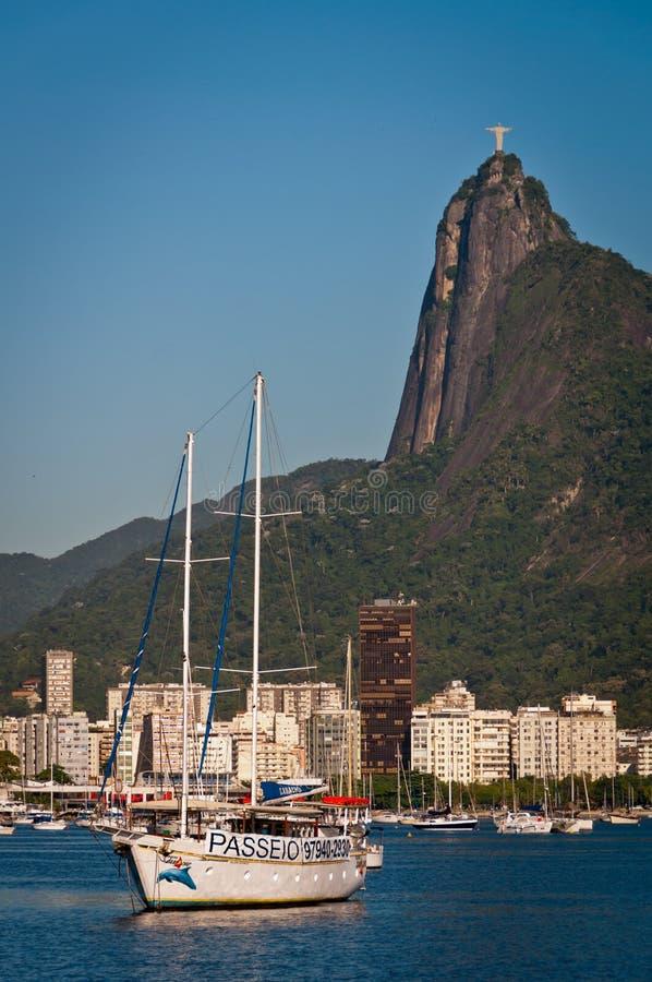 Tourist boat in Rio de Janeiro harbor with Corcovado Mountain stock photos