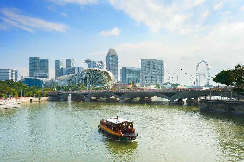 Tourist boat Singapore flyer Esplanade stock image