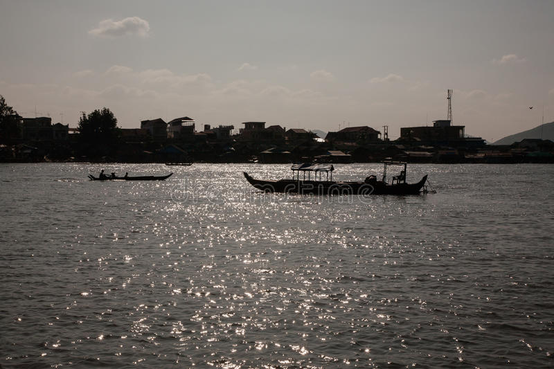 Tourist boats on the lake. Quite a large lake in Cambodia - Tonle Sap. He was even called inland sea of this country. However, its value is very variable stock photos