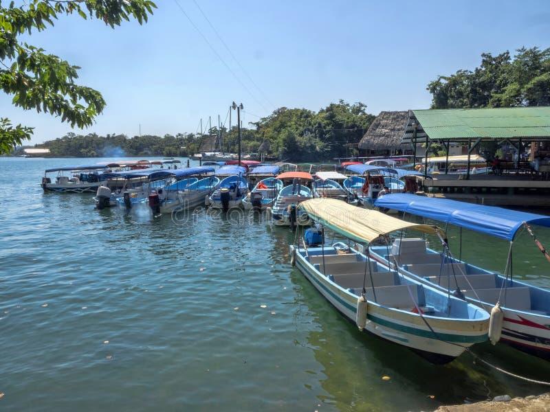 Tourist boats on Rio Dulce, Guatemala stock photo