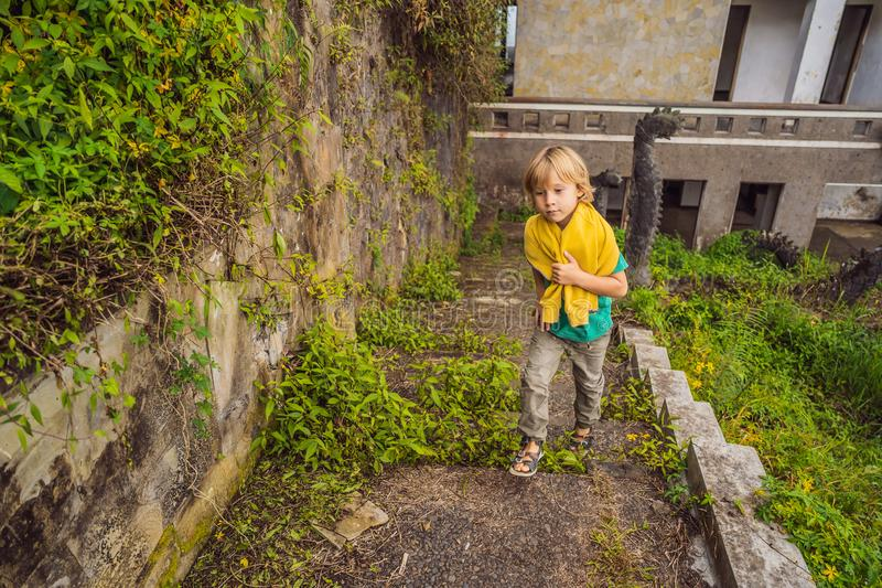 Tourist boy in abandoned and mysterious hotel in Bedugul. Indonesia, Bali Island. Bali Travel Concept.  royalty free stock photography