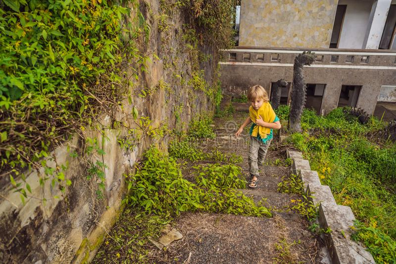 Tourist boy in abandoned and mysterious hotel in Bedugul. Indonesia, Bali Island. Bali Travel Concept.  stock image