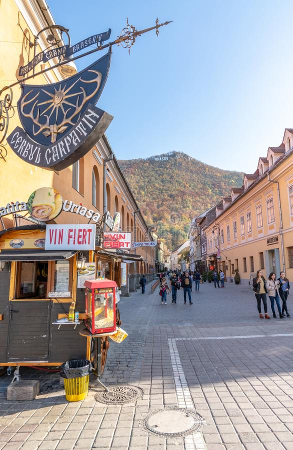 Tourist Brasov in Romania. One of the ten largest cities in Romania. Located in the heart of Romania, the city of Brasov is sometimes called the Romanian royalty free stock photos