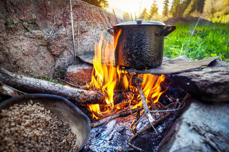 Tourist breakfast. Cooking on bonfire in the mountain forest, Almaty, Kazakhstan stock photos