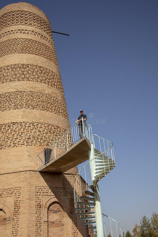 Tourist at Burana Tower, Balasagun, Kyrgyzstan stock photography