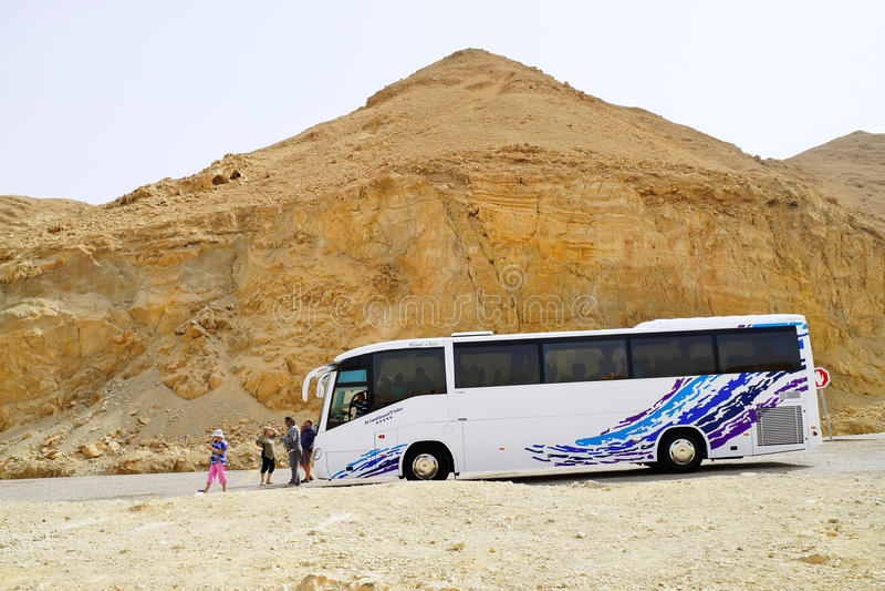 Tourist bus carrying tourists to the mountains stock photos