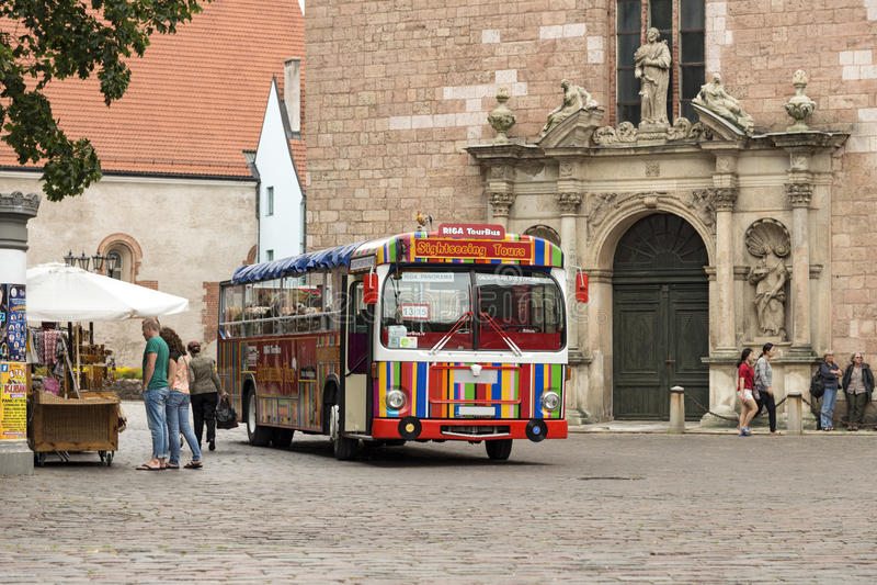 Tourist bus near St. Peter's Church. Riga, Latvia stock photography