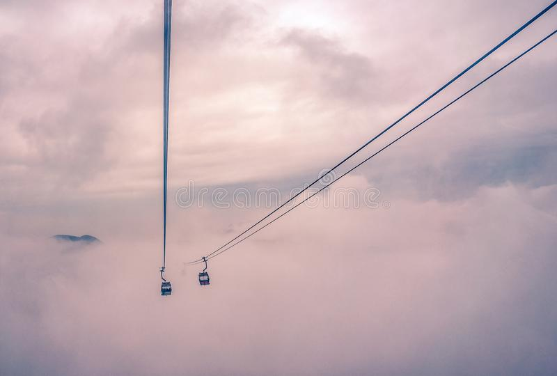 Tourist cable car in the mist : Minimal concept royalty free stock image
