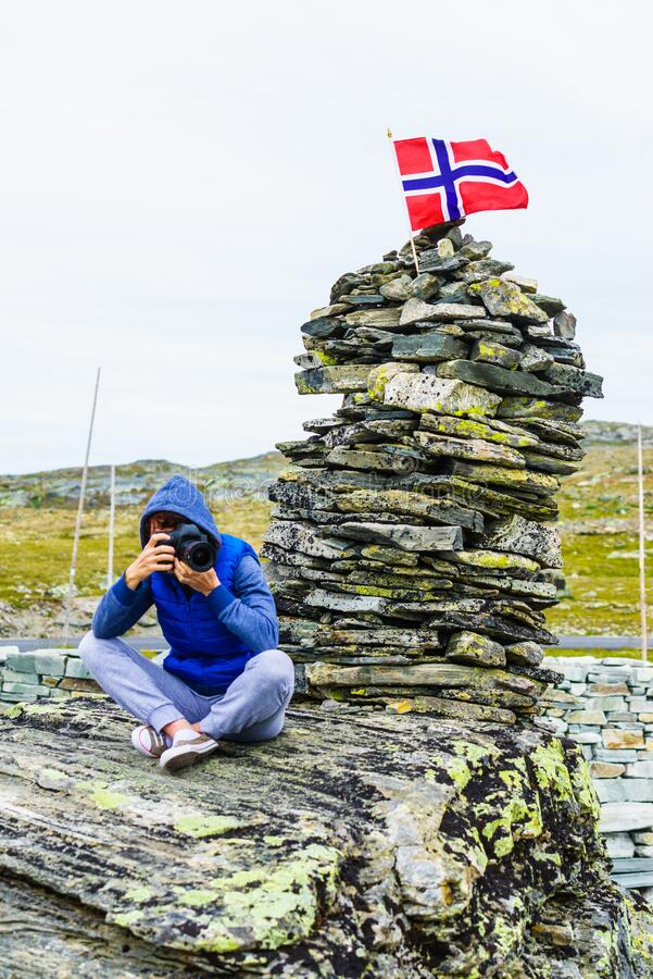 Tourist with camera in Norway mountains stock photography