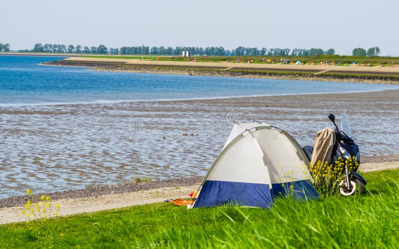 Tourist camping in a tent at the beach of tholen, touristic location in zeeland, the netherlands. A tourist camping in a tent at the beach of tholen, touristic stock image