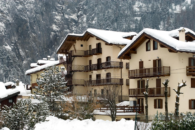 Tourist Chalets, Italy. Blocks of tourist chalets, after a heavy snowfall, Italy royalty free stock photo