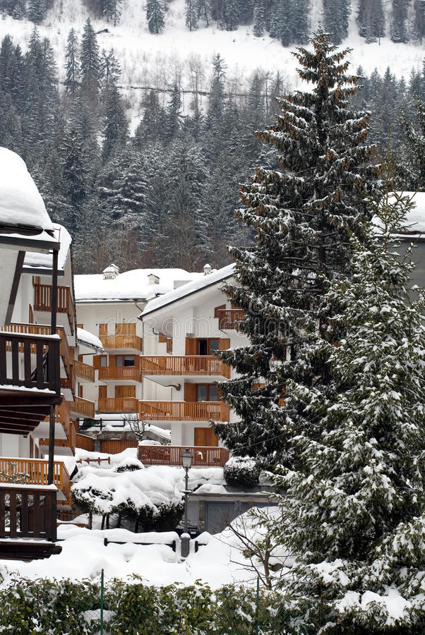 Tourist Chalets, Italy. Blocks of tourist chalets, after a heavy snowfall, Italy royalty free stock photos