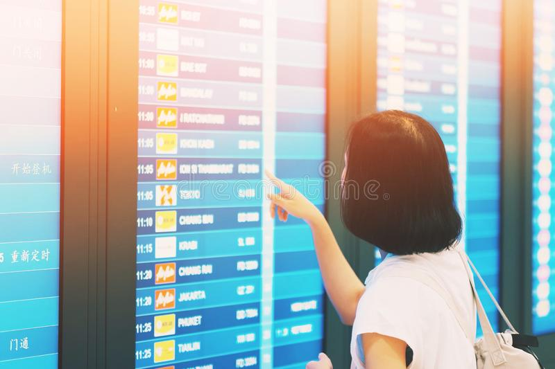 the tourist  Checking flights from the monitor in the airport royalty free stock photography