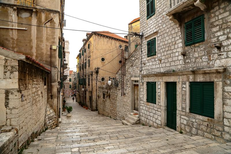 Tourist city by the Adratic sea - Sibenik, Croatia. The old stones, narrow street and stairs royalty free stock photography