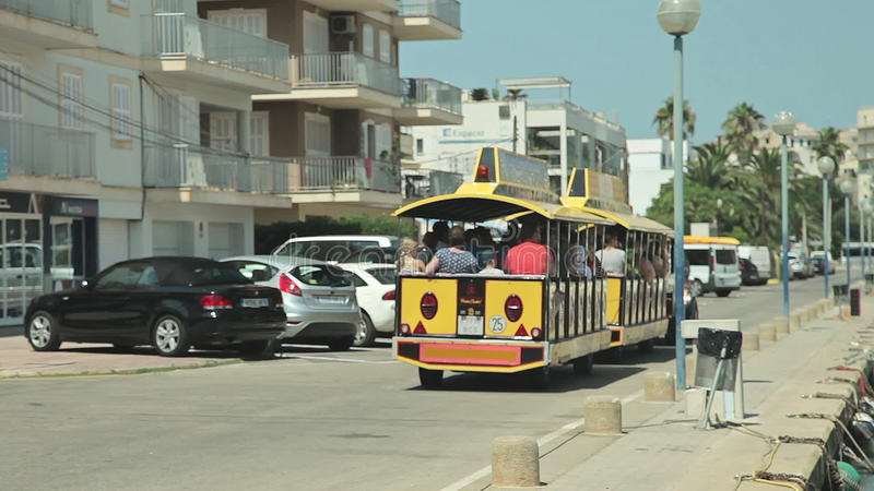 Tourist City Train With Trailers The Yacht Is Anchored Next To The Beach Area Spanish Parking For Yachts In A Stock Video Video Of Enjoyment Entertainment 92638911