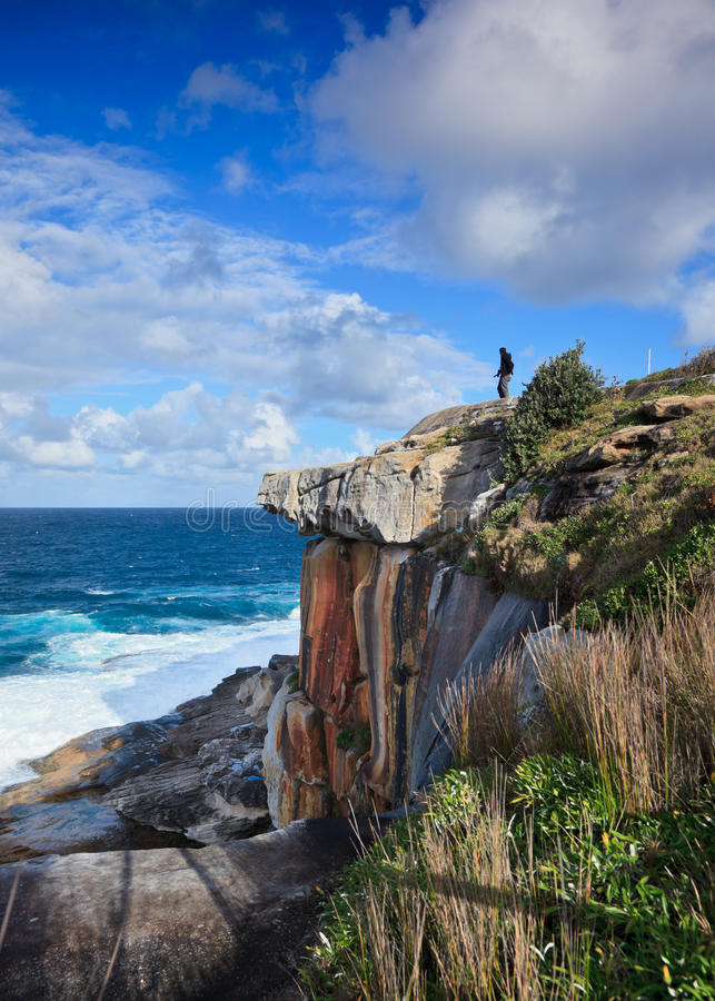 Download Person On Cliff Looking At Ocean Stock Image - Image: 20807133