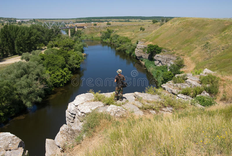 Download Tourist On A Cliff Above The River Stock Image - Image: 20843483