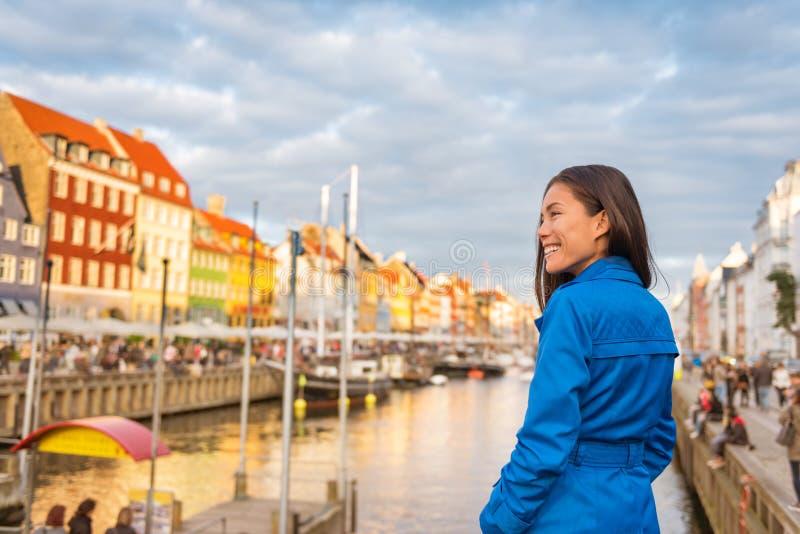 Tourist in Copenhagen. Chinese Asian woman traveler walking in Nyhavn visiting Denmark. City travel, tourism in Scandinavia stock images