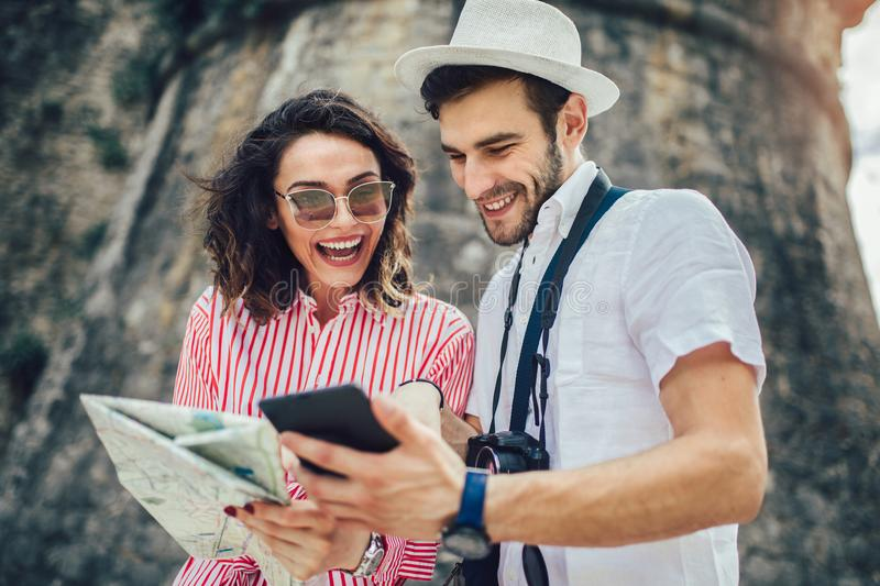 Tourist couple enjoying sightseeing, exploring city royalty free stock images