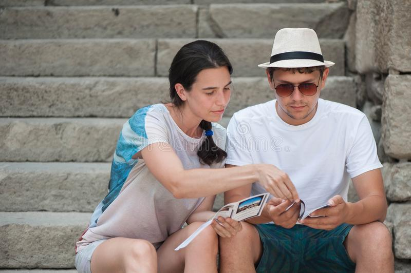 Tourist couple in love enjoying city sightseeing royalty free stock photos