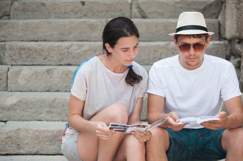 Tourist couple in love enjoying city sightseeing stock image