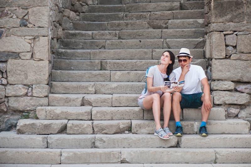 Tourist couple in love enjoying city sightseeing stock photography