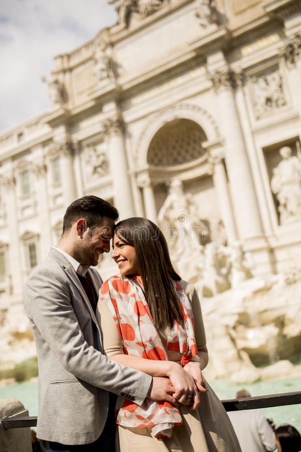 Tourist couple on travel by Trevi Fountain in Rome royalty free stock images