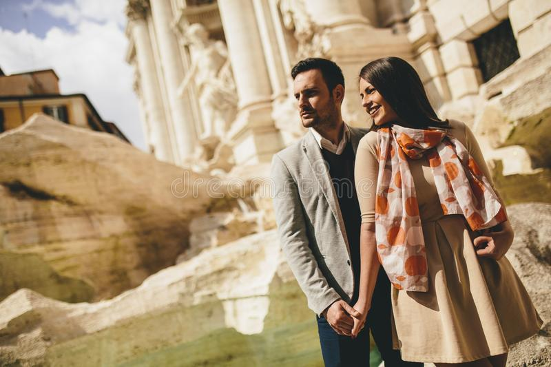 Tourist couple on travel by Trevi Fountain in Rome, Italy. Young tourist couple on travel by Trevi Fountain in Rome, Italy stock photos