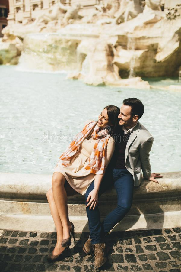 Tourist couple on travel by Trevi Fountain in Rome, Italy. Young tourist couple on travel by Trevi Fountain in Rome, Italy royalty free stock photo
