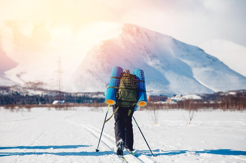 Tourist on cross-country skiing goes hiking royalty free stock photos