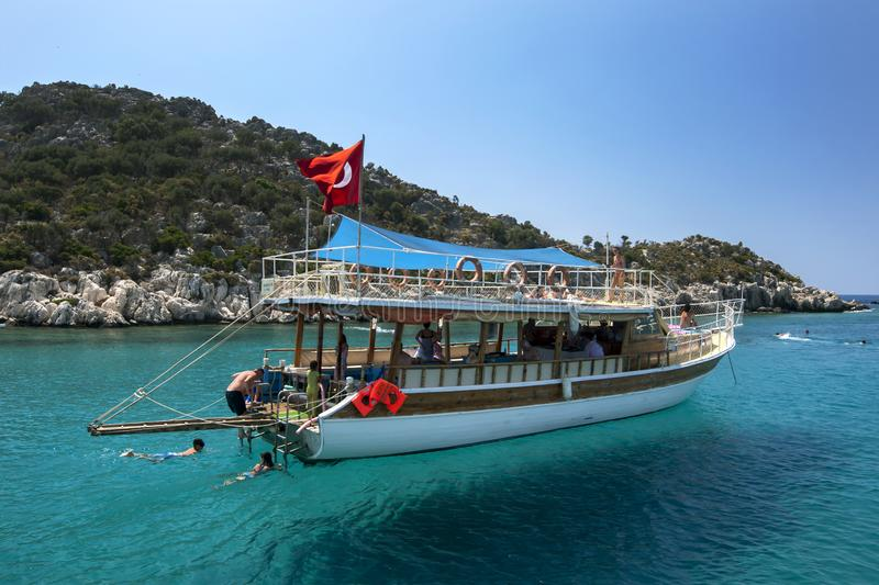 A tourist cruise boat anchored adjacent to the Sunken City of Simena. stock images
