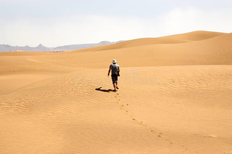 Tourist among the desert dunes