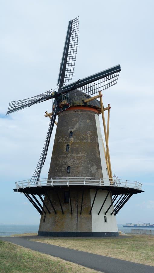 Tourist destination, Dutch windmill on sea shore, Vlissingen, Ze royalty free stock photo