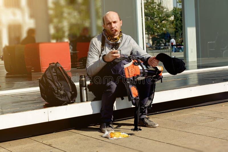 Tourist emigrant begging on the street. Tourist emigrant begging on the street in Italy stock photo