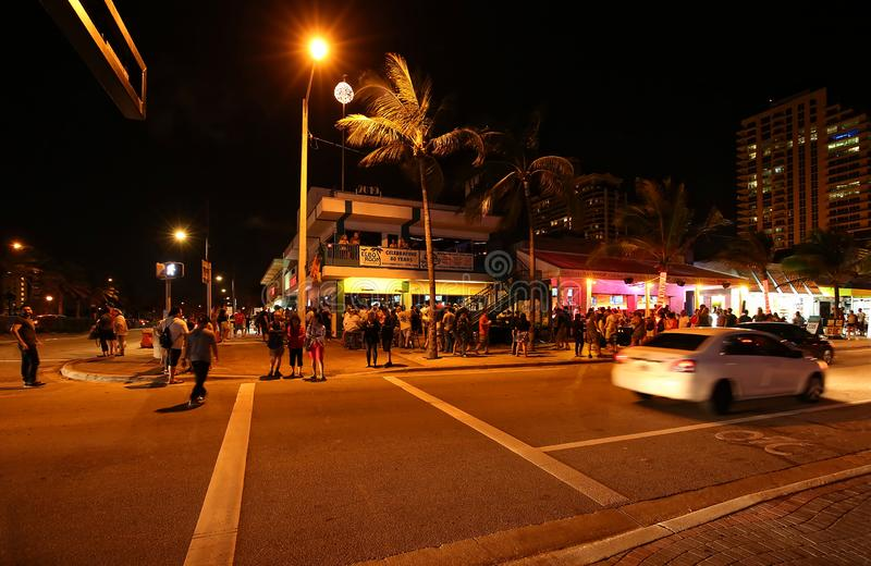 Tourist enjoy evening activities on Fort Lauderdale Beach royalty free stock photos