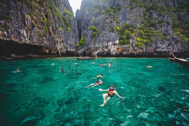 Snorkeling. Tourist enjoying snorkeling activity near island in krabi stock photography