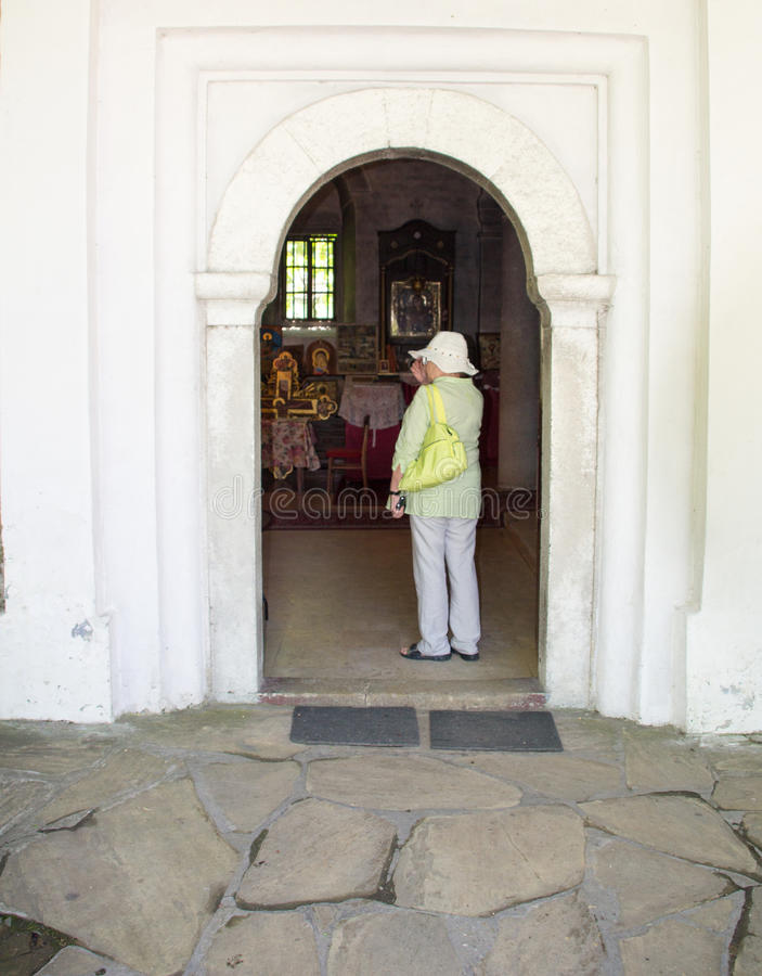 A tourist entering the temple of the monastery of Dryanovo, Bulgaria stock image