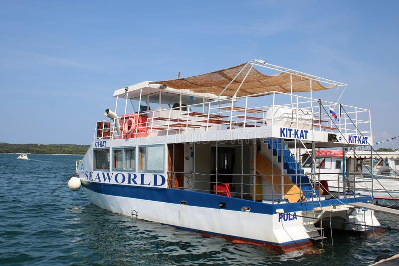 Tourist excursion boat, Pula harbor, Croatia royalty free stock photos
