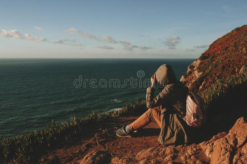 Tourist exploring Portugal. Cabo da Roca ocean and mountains view, authentic lifestyle capture royalty free stock photography