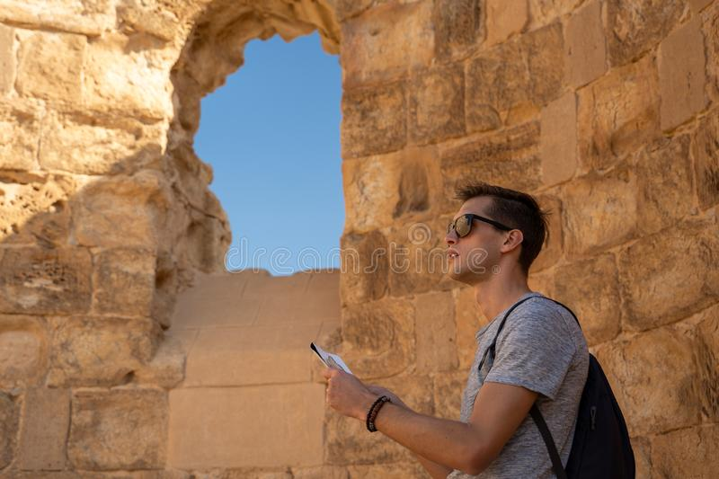 Young man exploring the ruins of masada in israel royalty free stock image