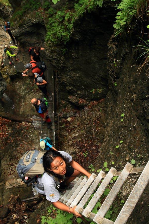Tourists climbing iron ladders in Slovak Paradise royalty free stock photo