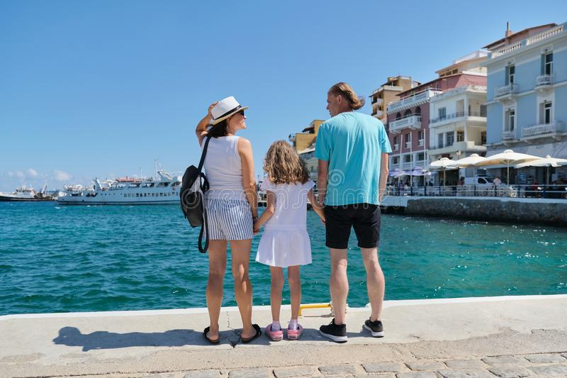 Tourist family back view, summer sea holidays stock photo