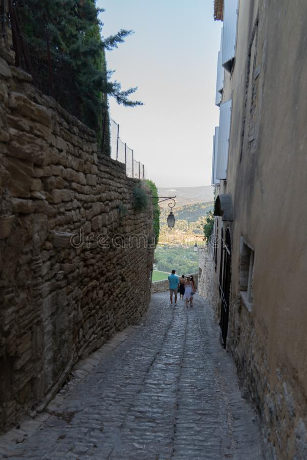 Tourist family in hill village of gordes Luberon Provence France stock photos