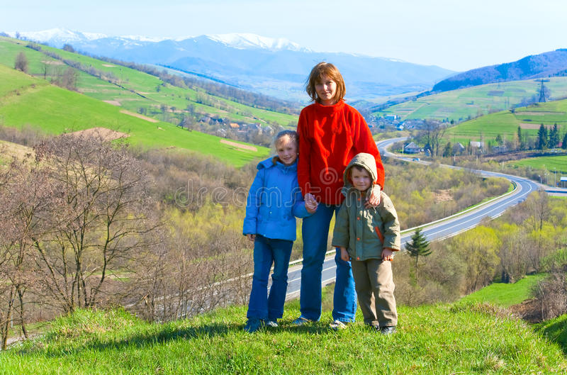 Tourist family and spring mountain country view