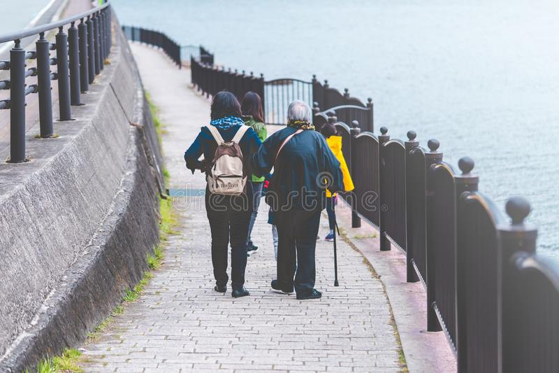 Tourist family walking on Kawaguchiko lake stock images