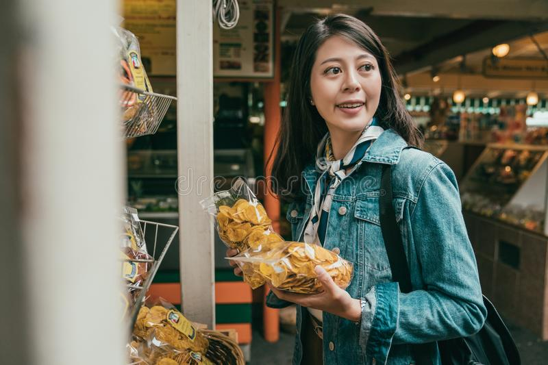 Tourist feels curious in the farmers market stock images