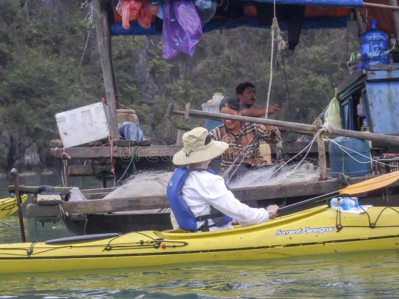 Tourist and fishermen in Ha Long Bay Vietnam royalty free stock photography